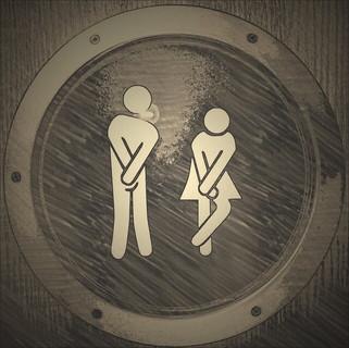 腹部を押さえる男性と女性のトイレのマーク